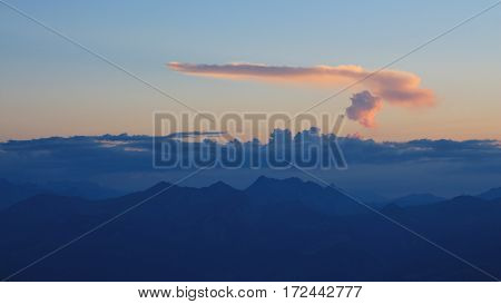 Colorful evening sky over mountains in the Swiss Alps.
