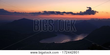 Sunrise view from mount Stanserhorn. Colorful sky over lake Vierwaldstattersee.