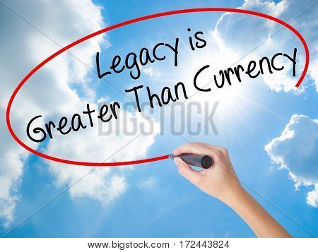 Woman Hand Writing Legacy Is Greater Than Currency With Black Marker On Visual Screen