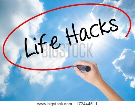Woman Hand Writing Life Hacks With Black Marker On Visual Screen