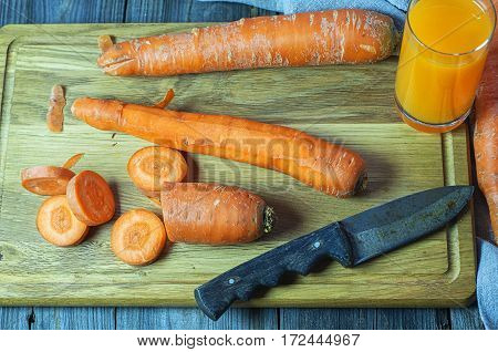 Fresh carrots on the chopping board for the carrot juice top view
