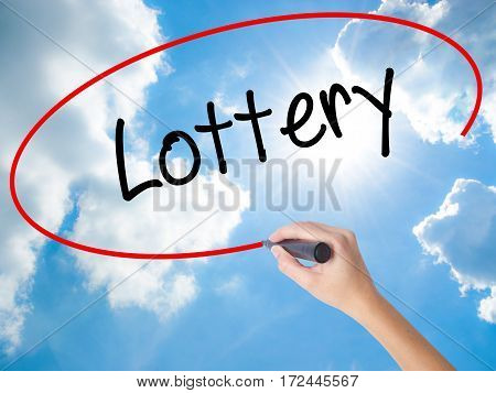 Woman Hand Writing Lottery  With Black Marker On Visual Screen