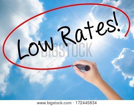 Woman Hand Writing Low Rates! With Black Marker On Visual Screen