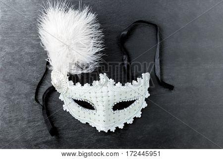Carnival mask on a black background. Purim Symbols