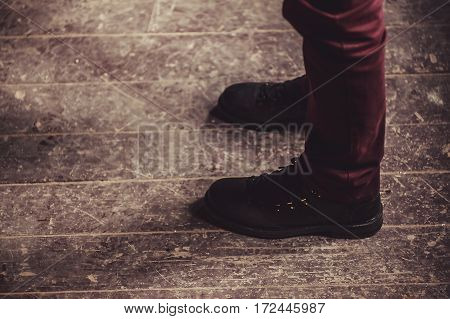 Abstract composition man is standing on old wooden floor.