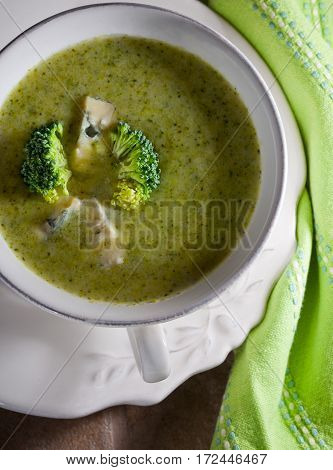 A bowl of creamy broccoli soup with blue cheese