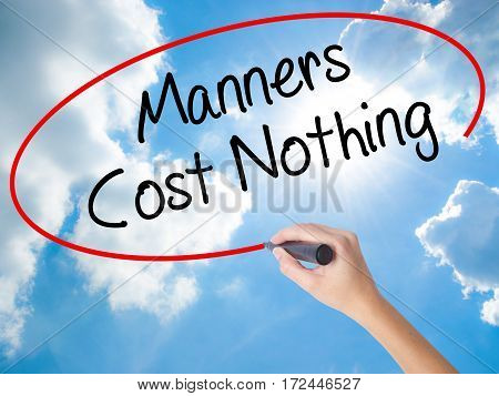 Woman Hand Writing Manners Cost Nothing With Black Marker On Visual Screen