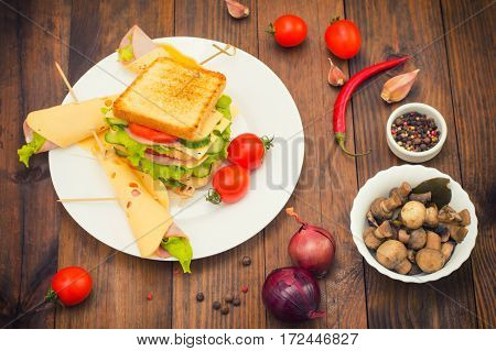 Big Sandwich, Meat, Lettuce, Cheese And Vegetables On Toasted. Wooden Background. Top View. Close-up