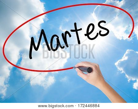 Woman Hand Writing Martes (tuesday In Spanish) With Black Marker On Visual Screen