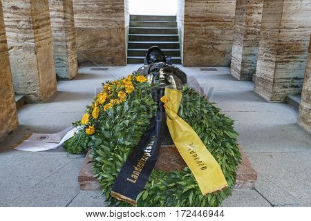 MUNICH, GERMANY - OCTOBER 31, 2015: The Kriegerdenkmal is a war memorial with a lying soldier in the Hofgarten and was built for commemorating those killed in action in World War I it is located on the eastern end of the Hofgarten in front of the Bayerisc