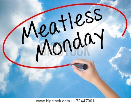 Woman Hand Writing Meatless Monday With Black Marker On Visual Screen