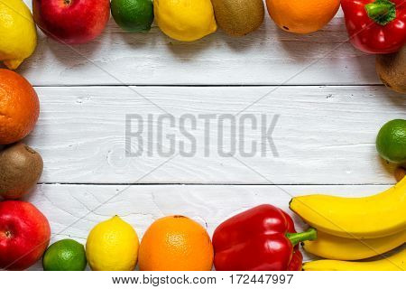 fresh fruits and vegetables for healthy diet on white wooden table with copy space. top view