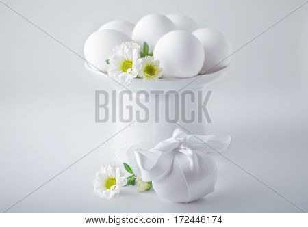 Eggs with flowers on a white background. Easter Symbols.