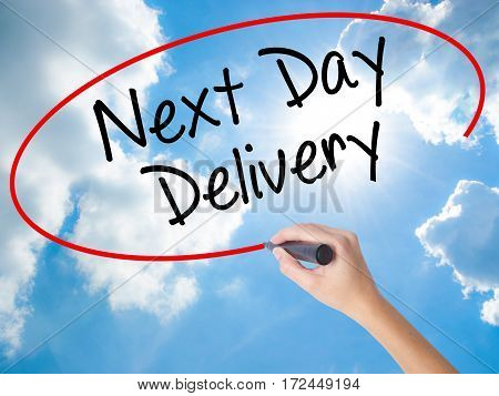 Woman Hand Writing Next Day Delivery With Black Marker On Visual Screen.