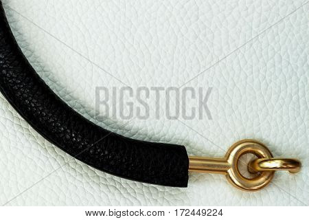 Close-up texture and bag handle of genuine leather handbag . For background , backdrop, substrate, composition use. With place for your text