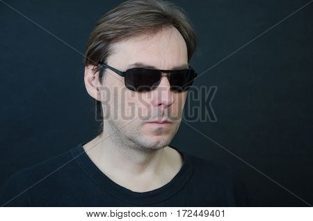 Man in black glasses with a long hair