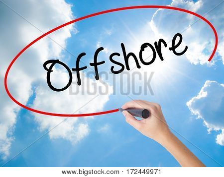 Woman Hand Writing Offshore With Black Marker On Visual Screen