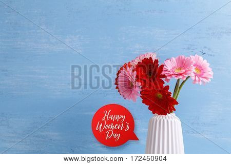 Gerbera flowers in vase on blue wood vintage background. 8 march or Valentines day love design. Fresh natural flowers. Happy womens day.