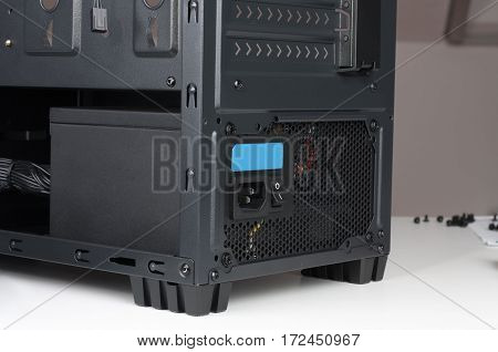 Black computer case; midi tower for ATX motherboard; with inserted power supply.