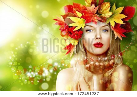 The girl in the image of autumn. Wreath of leaf fall.