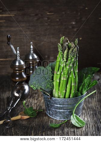 Fresh green vegetables: asparagus, broccoli and spinach