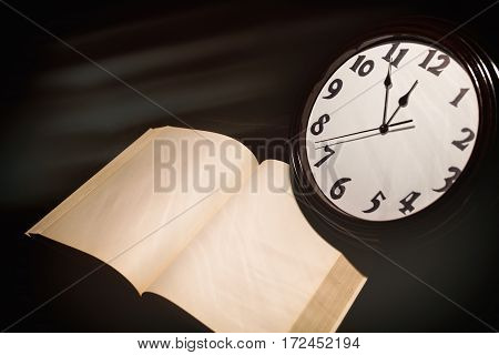 wall clock face and book concept of time control