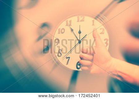 wall clock face and thumb up concept of success