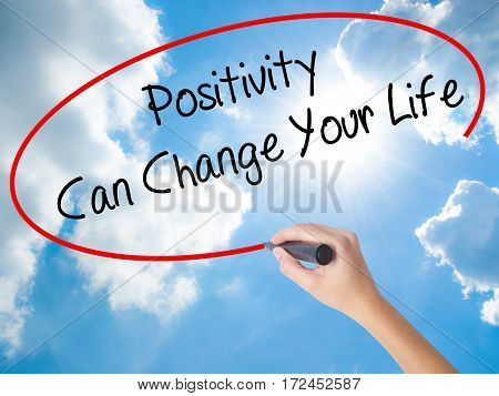 Woman Hand Writing Positivity Can Change Your Life With Black Marker On Visual Screen