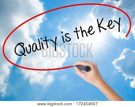 Woman Hand Writing Quality Is The Key With Black Marker On Visual Screen