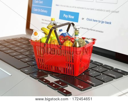 Shopping basket with variety of grocery products ion laptop keyboard. E-commerce concept 3d illustration