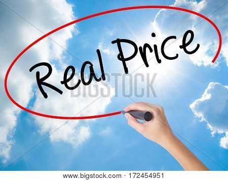 Woman Hand Writing Real Price With Black Marker On Visual Screen