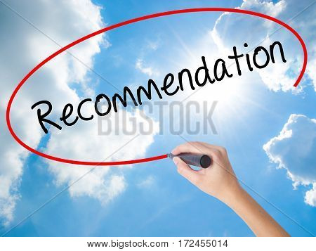 Woman Hand Writing Recommendation  With Black Marker On Visual Screen.