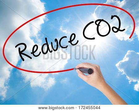 Woman Hand Writing Reduce Co2 With Black Marker On Visual Screen.
