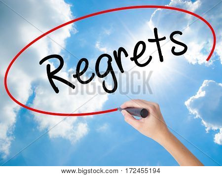 Woman Hand Writing  Regrets With Black Marker On Visual Screen