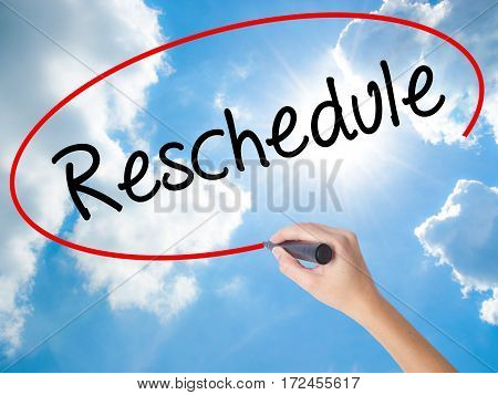 Woman Hand Writing Reschedule  With Black Marker On Visual Screen