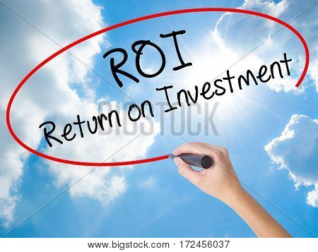 Woman Hand Writing Roi  Return On Investment With Black Marker On Visual Screen