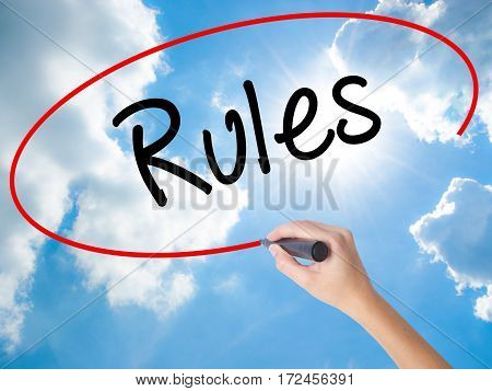 Woman Hand Writing Rules With Black Marker On Visual Screen.