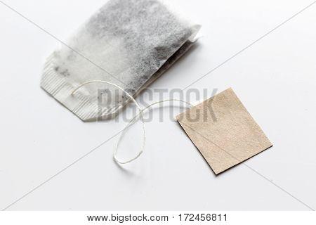 Close up black tea in teabag on white table background mock-up
