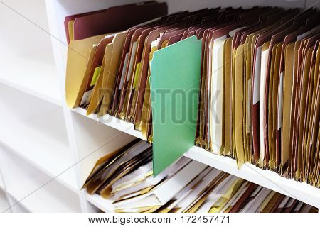 Green folder files in office for organization