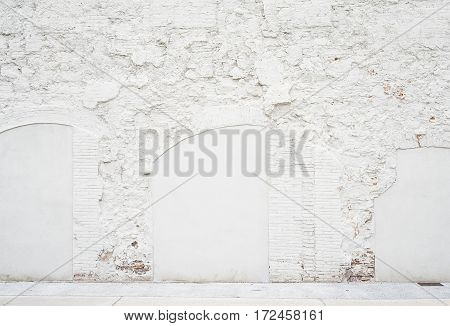 Abstract vintage empty background.Photo of grungy white painted brick wall texture. White washed brickwall surface.Horizontal mockup. Front side view