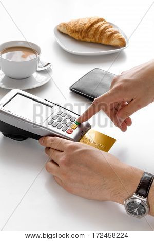 Payment by credit card for business break in cafe on white table background