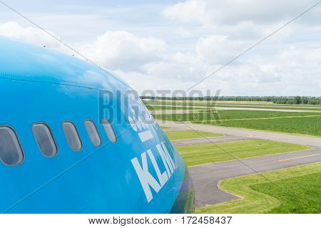 LELYSTAD NETHERLANDS - MAY 15 2016: side view of a blue KLM 747 jumbo jet at the aviodrome aerospace museum at lelystad airport