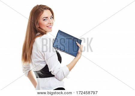 portrait of young businesswoman standing back turned with note book in hand looking over her shoulder isolated on whitebackground in photostudio
