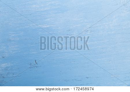 Blue wood background. Painted scraped wooden board. Grunge plywood texture or pattern.