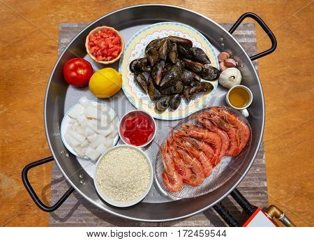 Seafood paella ingredients from Spain cuttlefish rice tomato shrimps