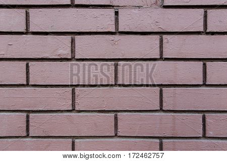 Old wall made of bricks with cement.