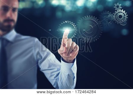 Businessman touching a gear mechanisms. business work with gears mechanism concept