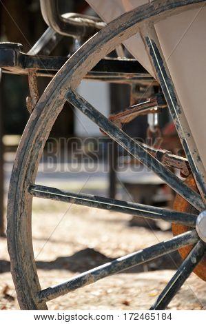 vertical shot horse drawn carriage wheel spoke
