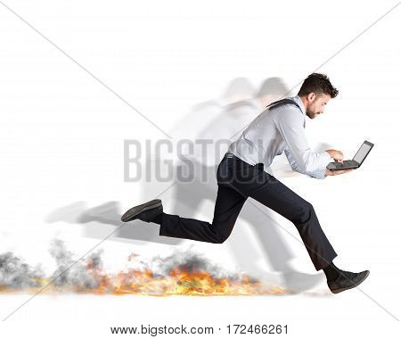 Businessman runs quickly with laptop leaving fire trails. Fast business concept