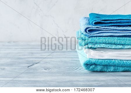 Blue towels set in laudry on gray table backgruond mock-up